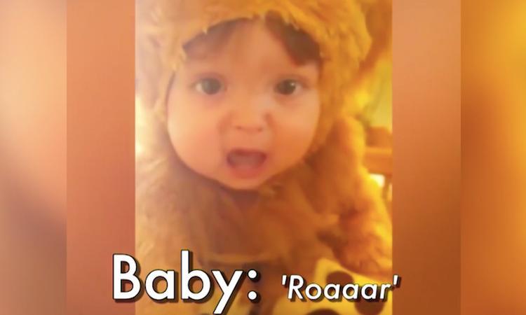 Baby in leeuwenpakje probeert te brullen